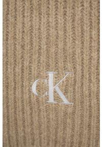Calvin Klein Jeans - Szalik z domieszką wełny. Kolor: beżowy. Materiał: wełna. Wzór: ze splotem