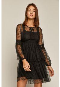 Czarna sukienka medicine z długim rękawem, casualowa, z aplikacjami, na co dzień