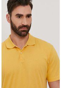 GAP - Polo. Okazja: na co dzień. Typ kołnierza: polo. Kolor: żółty. Materiał: dzianina. Długość: krótkie. Wzór: gładki. Styl: casual