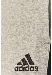 Adidas - adidas - Spodnie. Kolor: szary. Materiał: dzianina