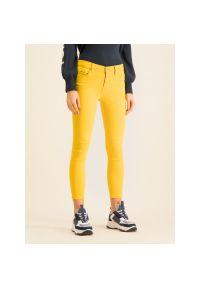Żółte jeansy slim Tommy Jeans