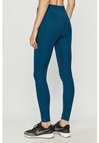 Nike - Legginsy. Kolor: niebieski. Materiał: tkanina, dzianina, poliester, elastan, włókno, skóra. Wzór: gładki #2