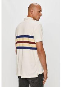 Biała koszulka polo Levi's® krótka, biznesowa, w kolorowe wzory, na spotkanie biznesowe