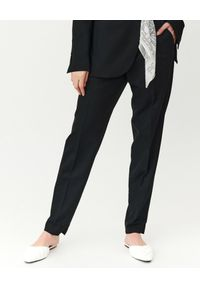 MMC STUDIO - Czarne spodnie z wełny Nova. Stan: podwyższony. Kolor: czarny. Materiał: wełna. Styl: elegancki