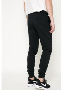 Ellesse - Spodnie. Kolor: czarny. Materiał: dzianina. Wzór: gładki