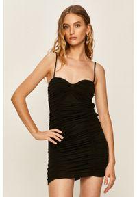 Pepe Jeans - Sukienka Telma x Dua Lipa. Kolor: czarny. Materiał: dzianina. Długość rękawa: na ramiączkach. Typ sukienki: dopasowane
