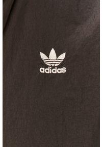 adidas Originals - Kombinezon. Kolor: czarny. Materiał: materiał