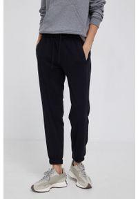 Drykorn - Spodnie Once. Kolor: czarny. Materiał: dzianina. Wzór: gładki