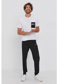 Calvin Klein Jeans - T-shirt bawełniany. Okazja: na co dzień. Kolor: biały. Materiał: bawełna. Styl: casual