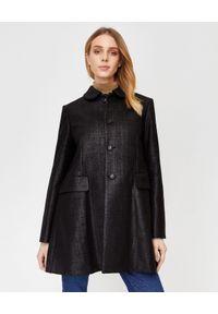 COMME des GARCONS - COMME DES GARCONS - Płaszcz z woskowanej wełny. Kolor: czarny. Materiał: wełna. Styl: wizytowy, elegancki
