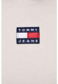 Tommy Jeans - Sukienka. Typ kołnierza: kaptur. Kolor: beżowy. Materiał: dzianina