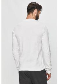 Biała bluza nierozpinana Calvin Klein Jeans casualowa, bez kaptura, z aplikacjami
