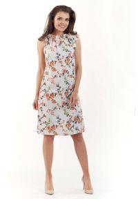 Lou-Lou - Ecru Kobieca Sukienka w Kwiatowy Wzór Kokardą na Ramieniu. Typ kołnierza: kokarda. Materiał: elastan, poliester. Wzór: kwiaty