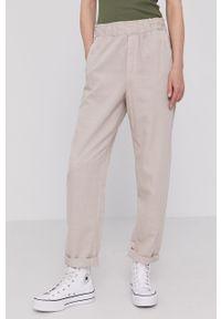 GAP - Spodnie. Okazja: na co dzień. Kolor: beżowy. Materiał: tkanina. Styl: casual