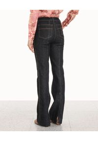 ZIMMERMANN - Granatowe jeansy z wysokim stanem. Stan: podwyższony. Kolor: niebieski