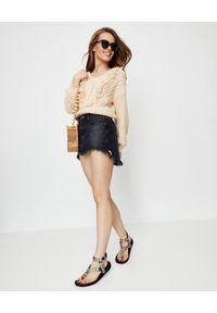 ONETEASPOON - Czarna jeansowa spódnica Junkyard. Stan: podwyższony. Kolor: czarny. Materiał: jeans. Wzór: aplikacja. Styl: boho
