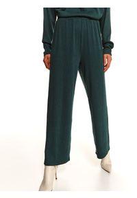 TOP SECRET - Luźne spodnie w prążki. Okazja: na co dzień. Kolor: zielony. Materiał: dresówka, dzianina. Długość: długie. Wzór: prążki. Sezon: zima. Styl: casual