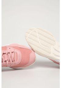 Różowe buty sportowe Puma na sznurówki, z okrągłym noskiem