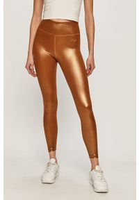 Nike - Legginsy. Stan: podwyższony. Kolor: złoty. Materiał: dzianina