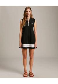 PALM ANGELS - Czarna sukienka dresowa. Kolor: czarny. Materiał: dresówka. Typ sukienki: rozkloszowane. Długość: mini