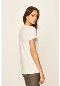 Under Armour - T-shirt. Kolor: biały. Materiał: dzianina. Wzór: melanż