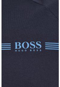 BOSS - Boss - T-shirt. Okazja: na co dzień. Kolor: niebieski. Materiał: bawełna. Długość rękawa: raglanowy rękaw. Wzór: nadruk. Styl: casual