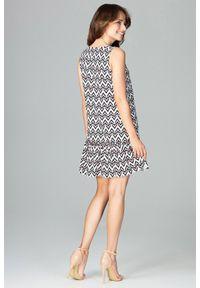 Sukienka koktajlowa elegancka, w geometryczne wzory