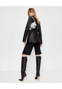 OFF-WHITE - Spodnie do kolan z logo. Kolor: czarny. Materiał: materiał. Długość: do kolan. Styl: elegancki