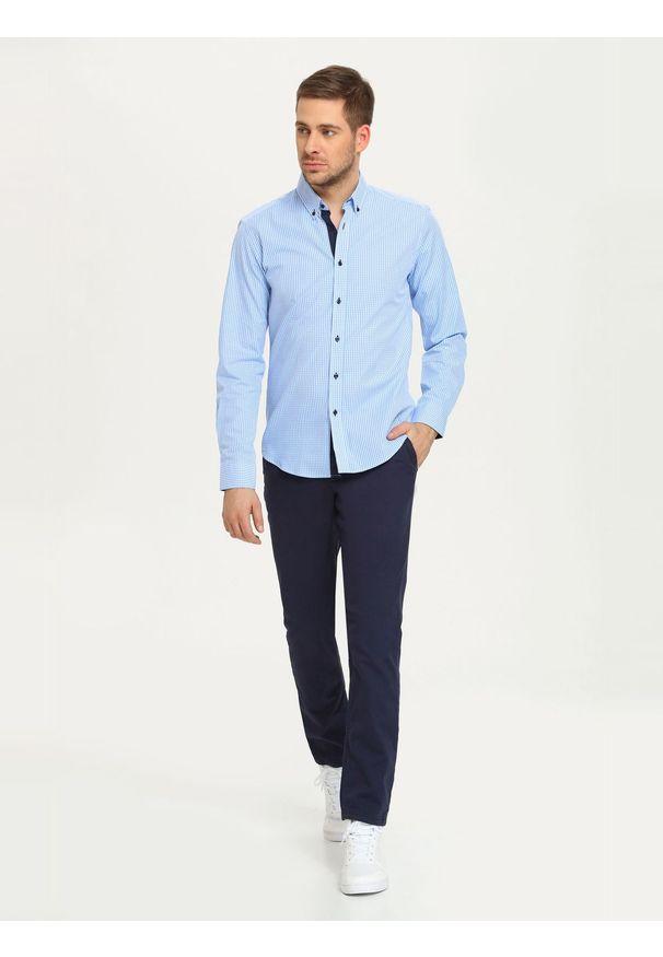 Niebieskie spodnie TOP SECRET długie, klasyczne, w kolorowe wzory
