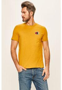 Żółty t-shirt Champion casualowy, z aplikacjami