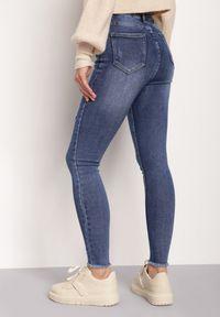 Renee - Niebieskie Jeansy Achyne. Stan: podwyższony. Kolor: niebieski. Wzór: aplikacja. Styl: elegancki #4
