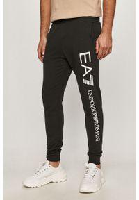 Czarne spodnie dresowe EA7 Emporio Armani z nadrukiem