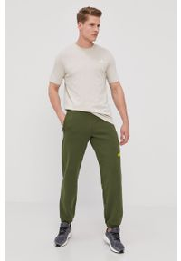 Oliwkowe spodnie dresowe adidas Performance z nadrukiem