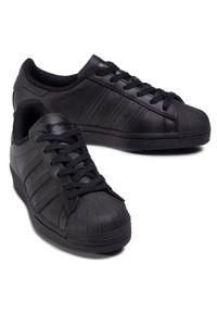 Adidas - Buty adidas - Superstar J FU7713 Cblack/Cblack/Cblack. Okazja: na urodziny, na co dzień. Zapięcie: pasek. Kolor: czarny. Materiał: skóra. Szerokość cholewki: normalna. Wzór: paski. Styl: młodzieżowy, retro, sportowy, klasyczny, casual, street