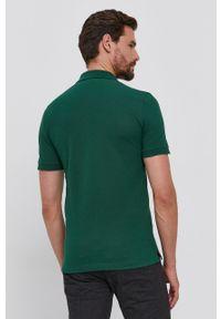Lacoste - Polo bawełniane. Typ kołnierza: polo. Kolor: zielony. Materiał: bawełna. Długość: krótkie. Wzór: gładki, aplikacja