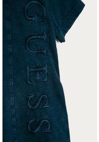 Niebieski t-shirt Guess z aplikacjami, casualowy