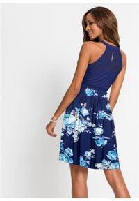 Sukienka w kwiaty bonprix ciemnoniebiesko-lila-jasnoróżowy. Kolor: niebieski. Wzór: kwiaty