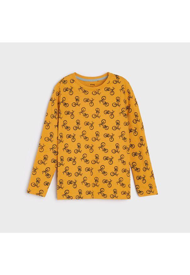 Sinsay - Bawełniana koszulka z nadrukiem - Pomarańczowy. Kolor: pomarańczowy. Materiał: bawełna. Wzór: nadruk