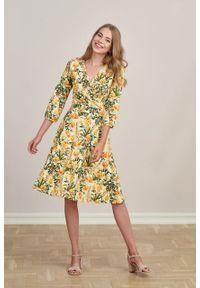 Marie Zélie - Sukienka Hermia Prado kremowa. Typ kołnierza: dekolt kopertowy. Kolor: kremowy. Materiał: bawełna, dzianina, materiał, elastan, skóra. Długość rękawa: krótki rękaw. Typ sukienki: kopertowe