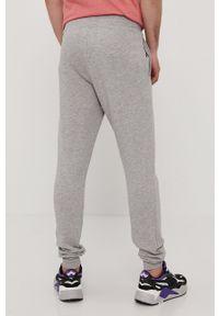 New Balance - Spodnie. Kolor: szary