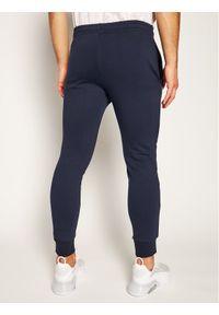 Lacoste Spodnie dresowe XH9507 Granatowy Regular Fit. Kolor: niebieski. Materiał: dresówka
