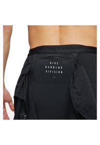 Spodnie legginsy męskie do biegania Nike Dri-FIT Phenom Run Division DD4878. Materiał: prążkowany, materiał, poliester. Technologia: Dri-Fit (Nike). Wzór: aplikacja. Sport: bieganie