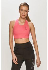 Fila - Biustonosz sportowy. Kolor: różowy. Rodzaj stanika: odpinane ramiączka