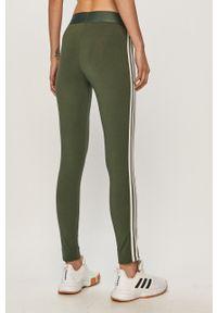 Zielone legginsy Adidas z aplikacjami