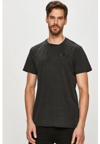Guess - T-shirt. Okazja: na co dzień. Kolor: czarny. Materiał: bawełna, dzianina. Wzór: gładki. Styl: casual