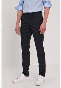 BOSS - Boss - Spodnie. Kolor: niebieski