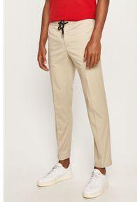 Beżowe spodnie TOMMY HILFIGER na co dzień, casualowe