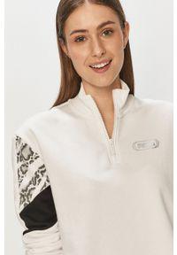Puma - Bluza. Okazja: na co dzień. Kolor: biały. Materiał: bawełna. Długość: krótkie. Styl: casual