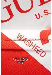 Pomarańczowy plecak Guess Jeans z nadrukiem