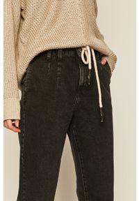 Czarne jeansy medicine w kolorowe wzory #6